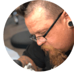Jeremy Aue headshot doing tattoo removal